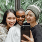 Three young women take a selfie together