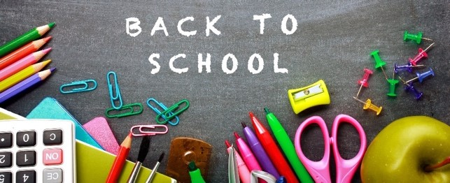 dark surface with colourful school supplies and the words 'Back to school'