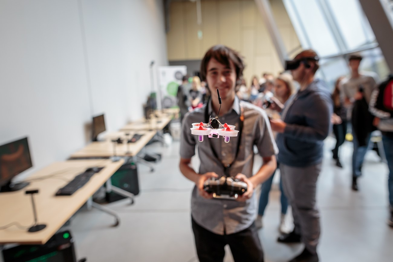 Playing with drones in the exhibition area during a break, DYF 2018, photo: M. Kruger