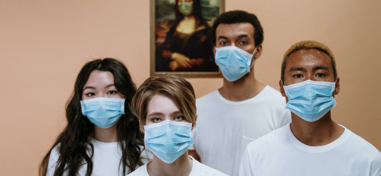 4 young people wearing surgical masks