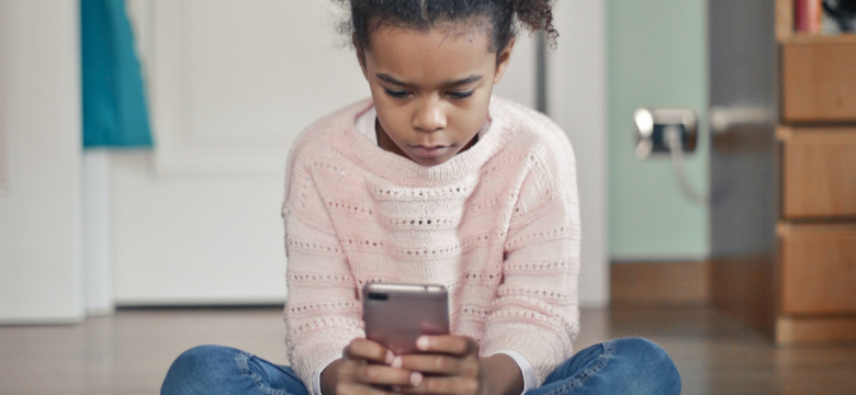 Young girl using a smartphone